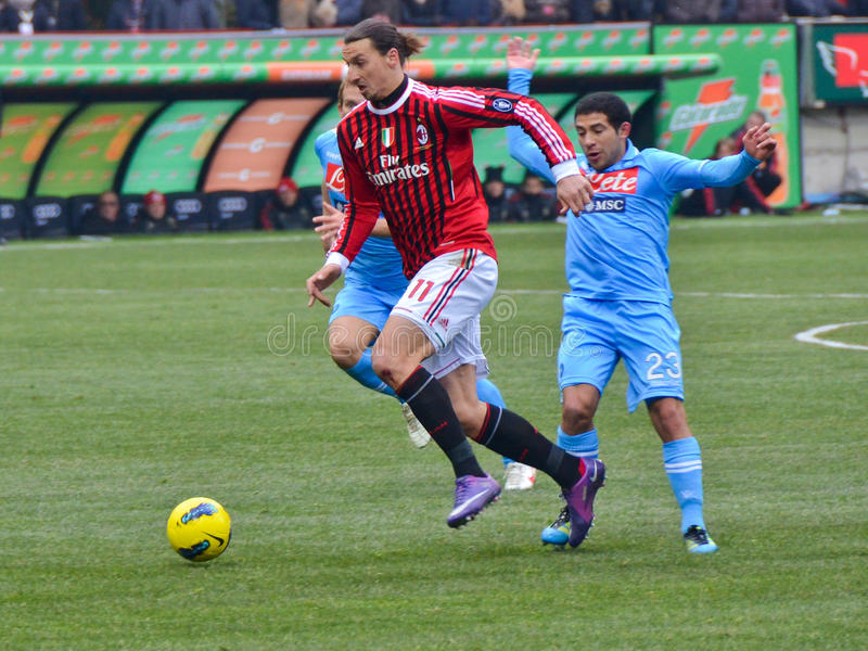 Zlatan Ibrahimovic. MILAN, ITALY - FEBRUARY 05: Zlatan Ibrahimovic(11) and Walter Gargano (23) in action during match Serie A AC Milan - Napoli (0:0) at the royalty free stock photography