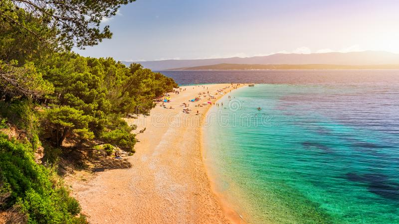 Zlatni Rat (Golden Cape or Golden Horn) famous turquoise beach in Bol town on Brac island, Dalmatia, Croatia. Zlatni Rat sandy. Beach at Bol on Brac island of stock photography
