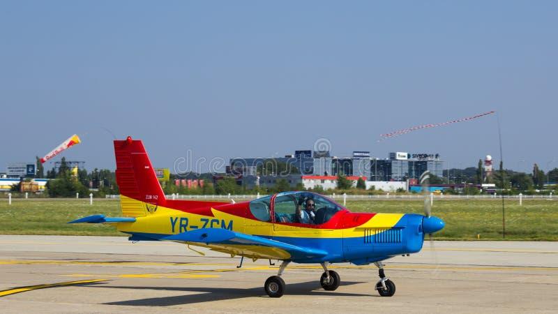 Zlin Z-142 YR-ZCM. Romanian Airclub Zlin Z-142 YR-ZCM after aerobatics at Bucharest International Air Show 2013 stock photo