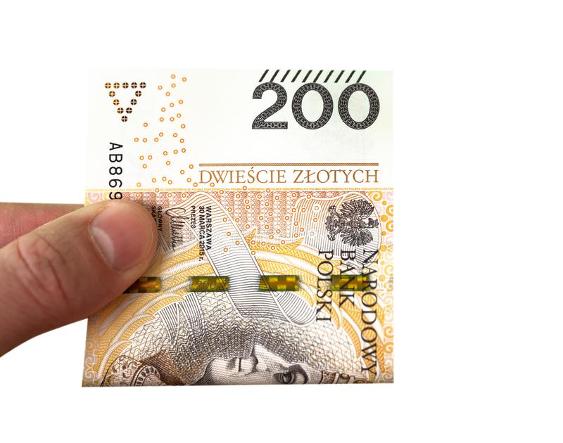 200 zloty banknote in a hand of a young man. Close up. stock images