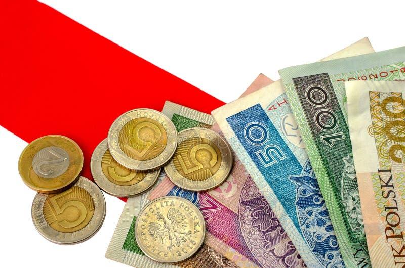 Zloty polacco Molte banconote e monete della denominazione differente immagine stock libera da diritti