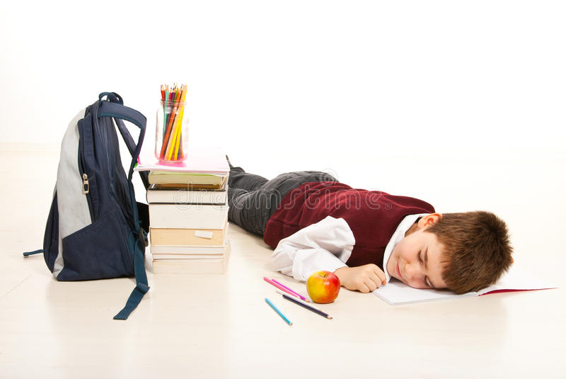 Zmęczona studencka chłopiec obrazy royalty free