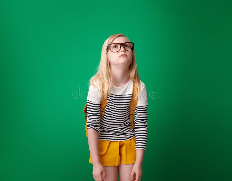 Zmęczona szkolna dziewczyna przyglądająca przy kopii przestrzenią up obrazy royalty free