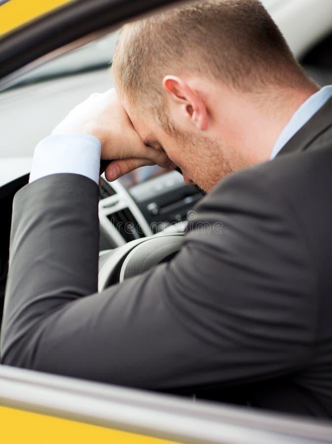 Zmęczony biznesmen lub taxi kierowca zdjęcie royalty free