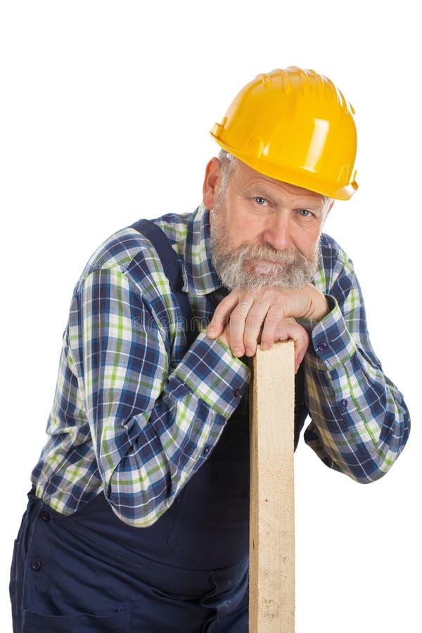 Zmęczony męski inżynier trzyma lath - odosobniony tło fotografia stock