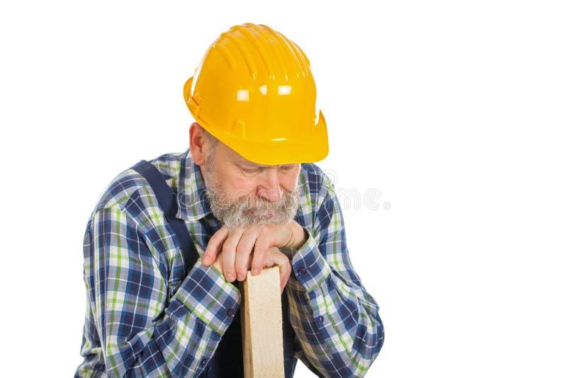Zmęczony męski inżynier trzyma lath - odosobniony tło zdjęcia royalty free