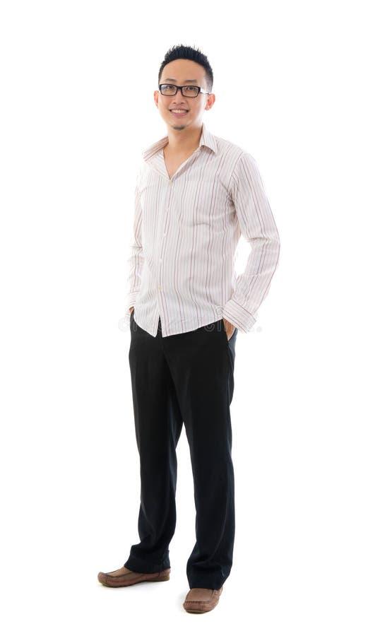 Zmęczony upaćkany szczęśliwy azjatykci biznesowy mężczyzna zdjęcie royalty free