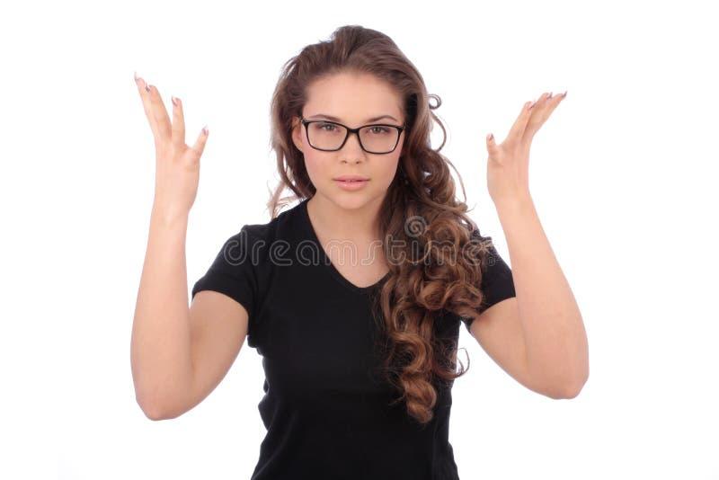 Zmartwione nastoletniej dziewczyny rozszerzania się ręki i no znają czego robić zdjęcie stock