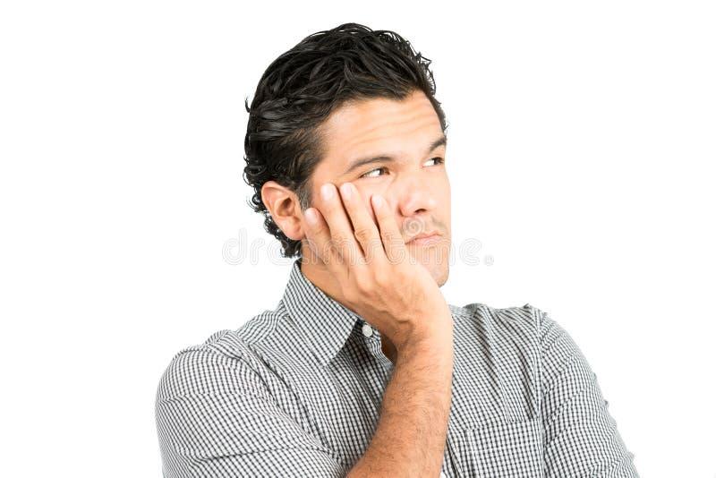 Zmartwionych Poważnych myśli mężczyzna Latynoska głowa W ręce fotografia stock