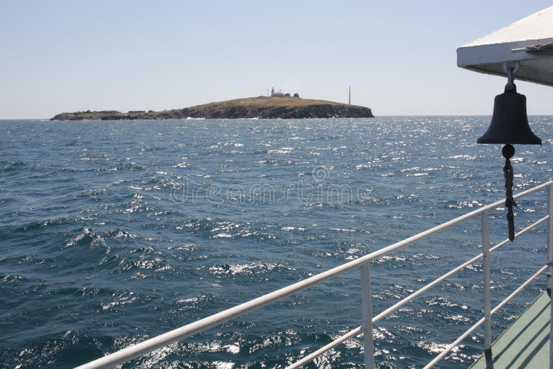 Zmeiniy island. Island Zmeiniy from the vessel stock photography