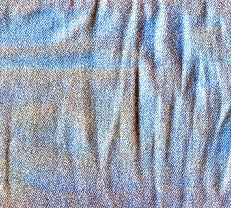 Zmięty cajgu tło Powyginana drelich powierzchnia obrazy stock
