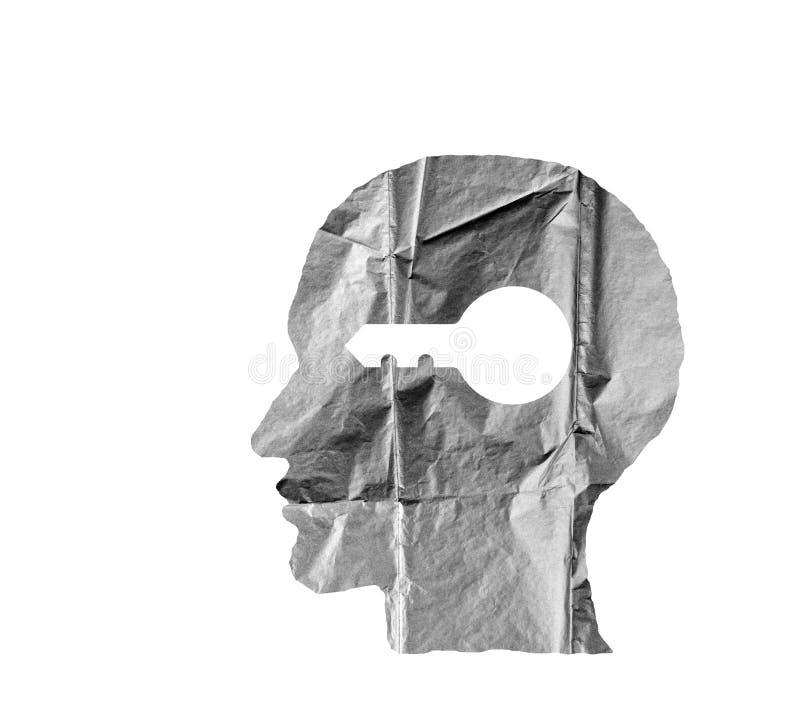 Zmięty papier kształtujący jako ludzka głowa klucz na bielu i zdjęcie stock