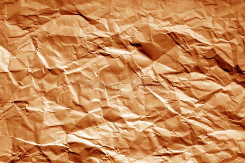 Zmięty prześcieradło papier z plama skutkiem w pomarańczowym brzmieniu zdjęcie stock