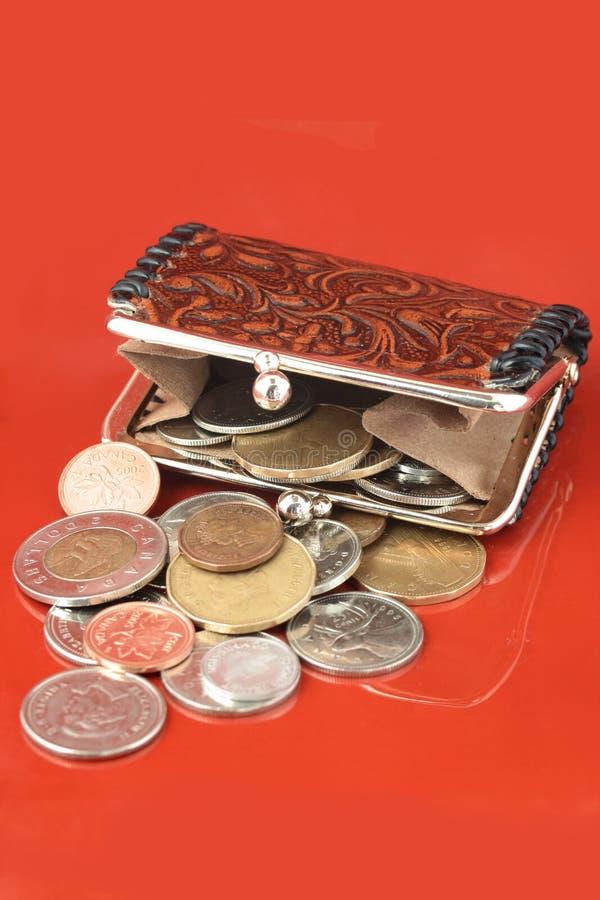 zmiana pieniądze torebka fotografia stock