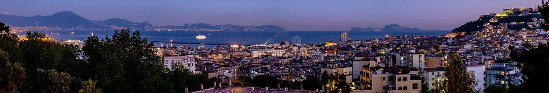 Zmierzch na Naples pejzażu miejskim obrazy royalty free