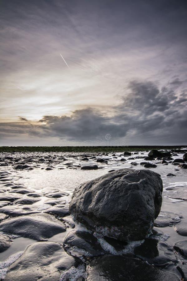 Zmierzch nad holender plaża fotografia royalty free