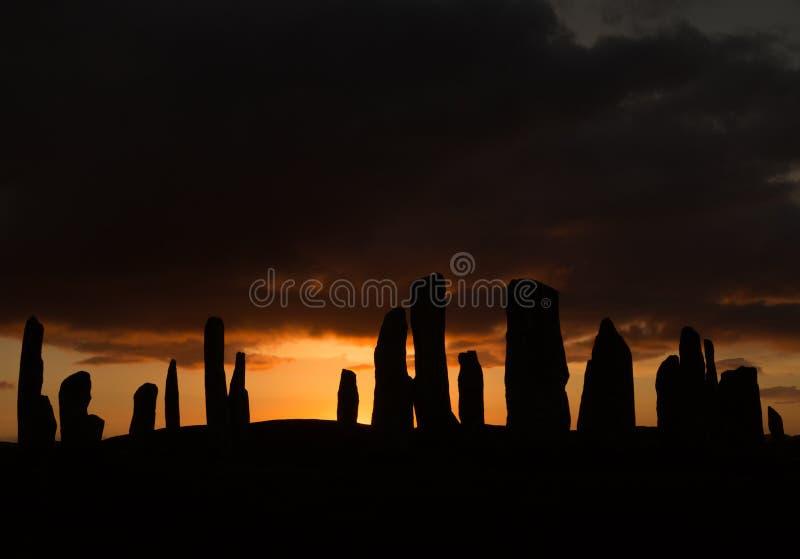 Zmierzch przy Callanish pozyci kamieniami obrazy royalty free