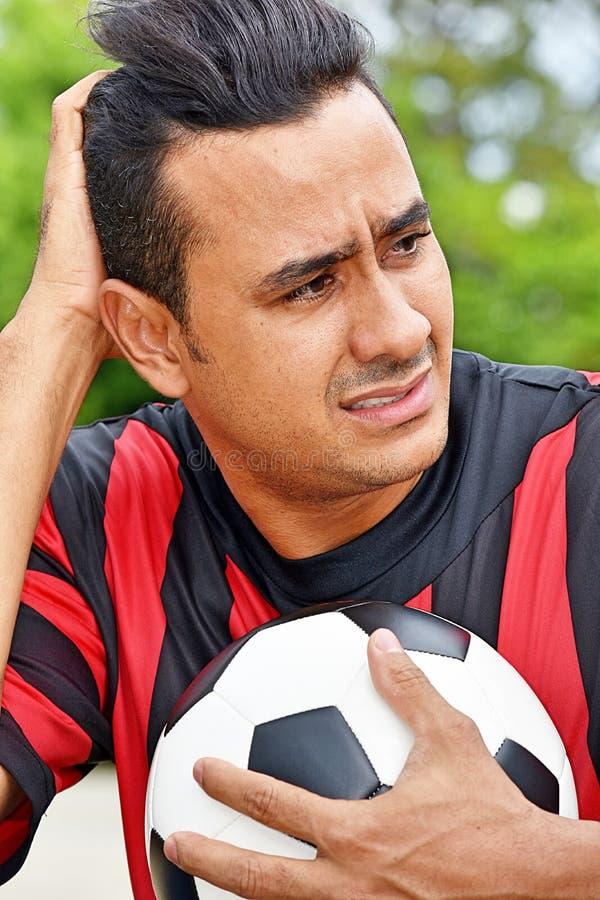 Zmieszany Dorosłej samiec gracz piłki nożnej obrazy stock