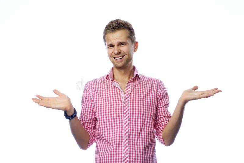 Zmieszany przystojny mężczyzna na bielu zdjęcia stock