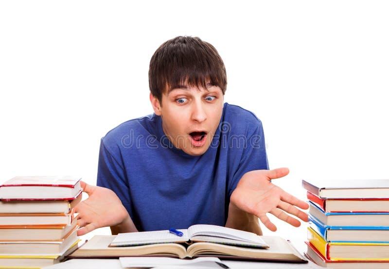 Zmieszany uczeń z książki zdjęcie stock