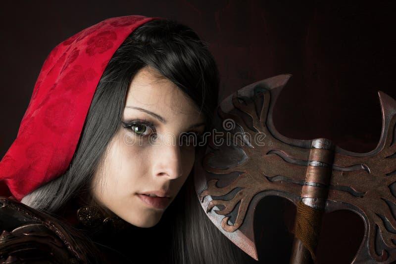 Zmrok - czerwony Jeździecki kapiszon fotografia stock