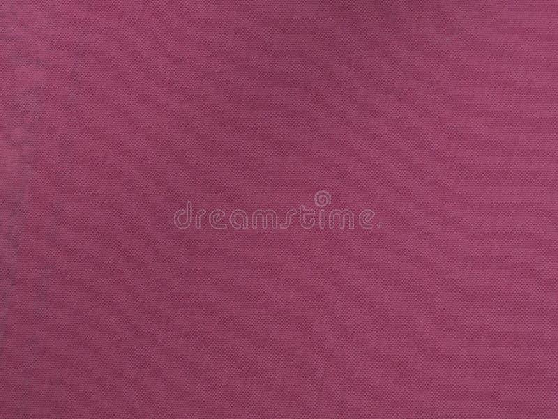Zmrok - czerwony sukienny tekstylnego materiału tekstury tła wzór fotografia stock