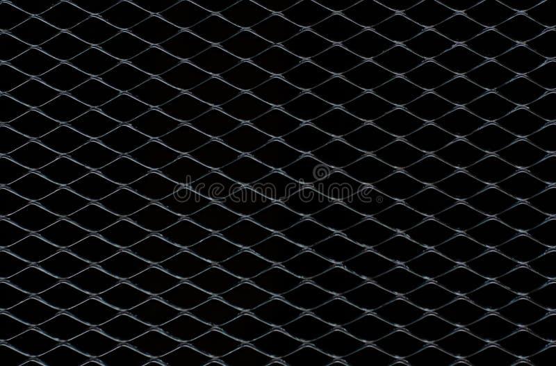 Zmrok - szarość i srebro siatka metalu ogrodzenie ten brać jako tło zdjęcia royalty free