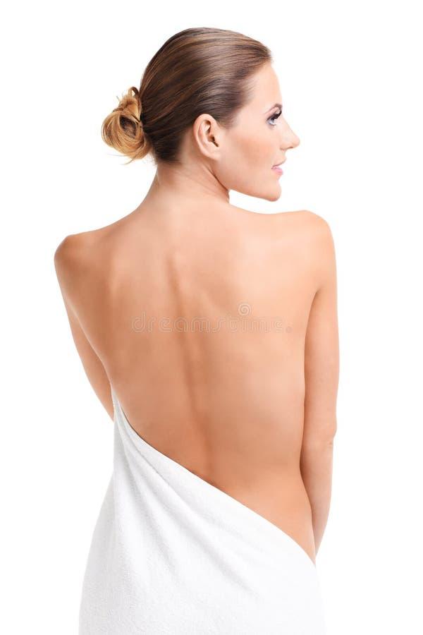 Zmysłowa naga kobieta z ręcznikiem obrazy stock