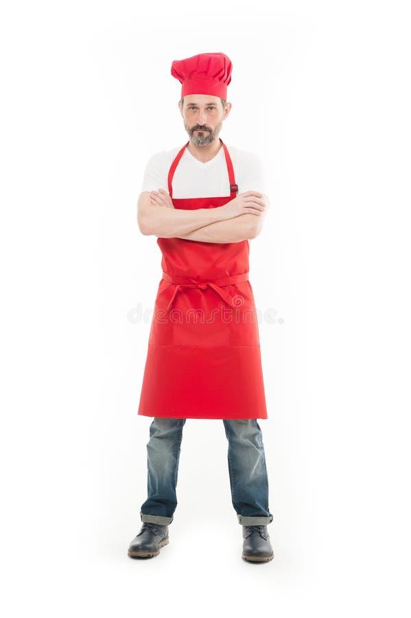 Znać dla jego kucharstwa Brodaty dorośleć mężczyzny w szefa kuchni fartuchu i kapeluszu Seniora kucharz jest ubranym śliniaczka f zdjęcia royalty free