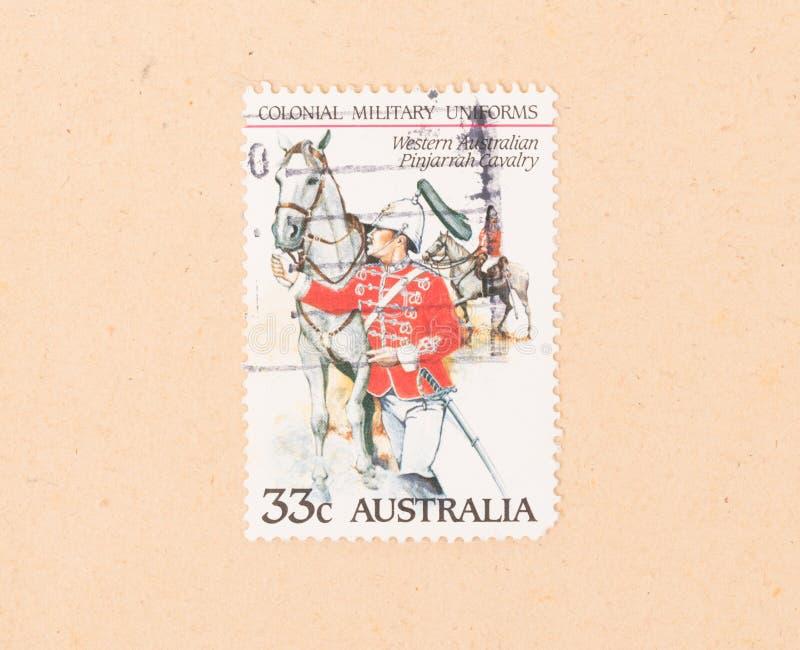 Znaczek drukujący w Australia pokazuje wojskowego uniform około 1980, obrazy royalty free