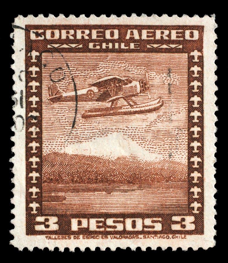 Znaczek drukujący w Chile pokazuje Stinson Faucett F 19 hydroplan w locie zdjęcie royalty free