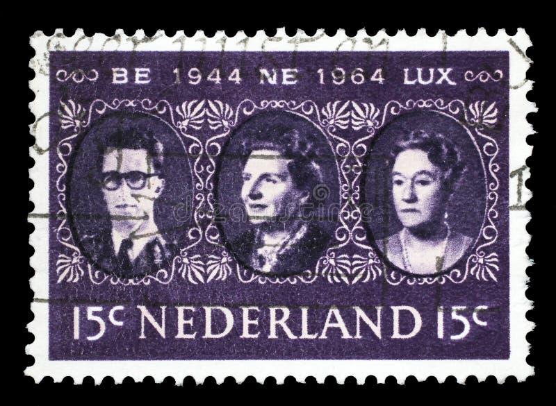 Znaczek drukujący w holandiach pokazuje królewiątko Baudouin, królowej Juliana i Uroczystego Duchess Charlotte, Benelux obrazy royalty free