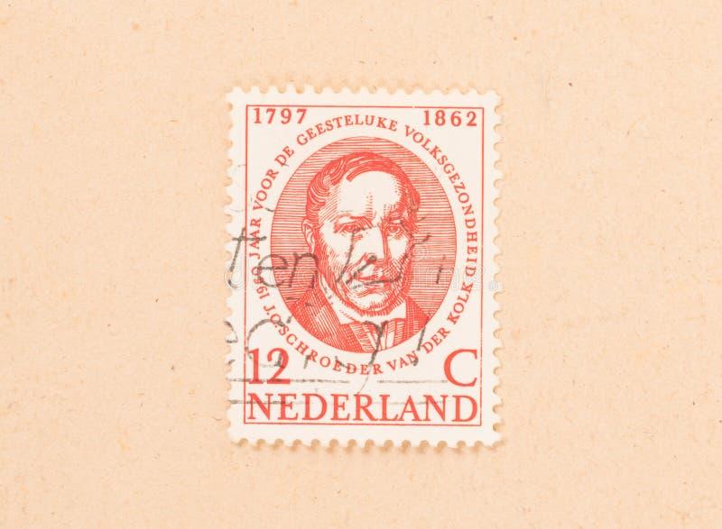 Znaczek drukujący w holandiach pokazuje mężczyzny około 1960, zdjęcia royalty free