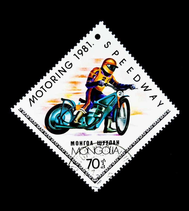 Znaczek drukujący w Mongolia pokazuje wizerunek motocyklu drogowy ścigać się zdjęcia royalty free
