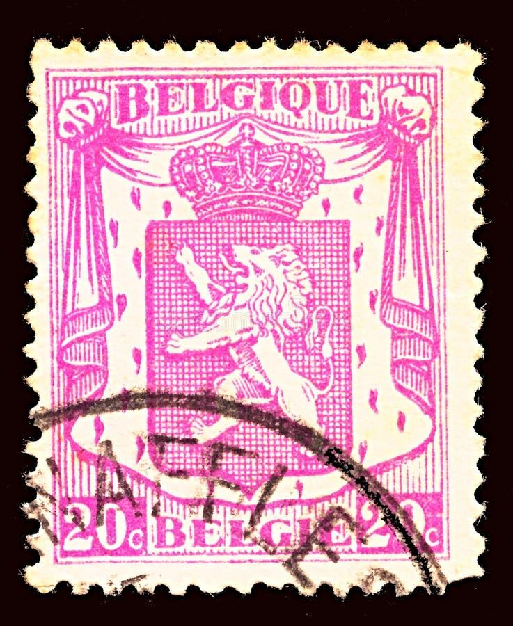 Znaczek pocztowy drukujący w Belgia pokazuje żakiet ręki Belgia, około 1938 fotografia stock