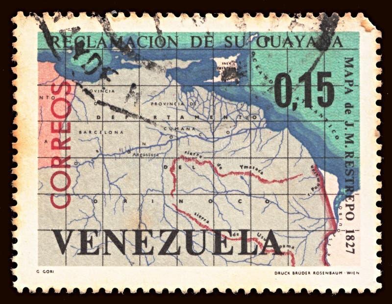 Znaczek pocztowy drukujący w Wenezuela przedstawień mapie WENEZUELA I GUIANA fotografia stock