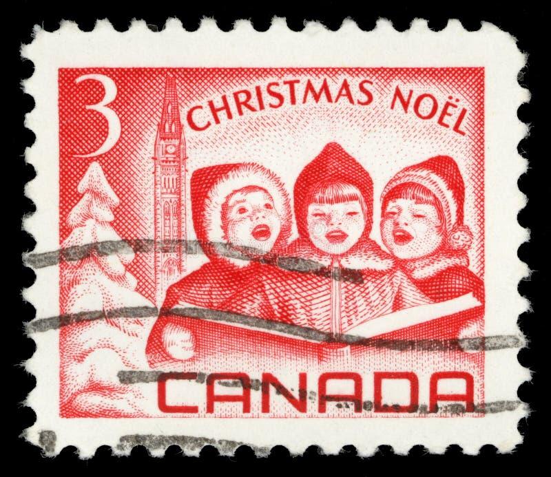 Znaczki drukujący w Kanada, przedstawiają Śpiewackich dzieci i pokoju wierza, Ottawa zdjęcia royalty free
