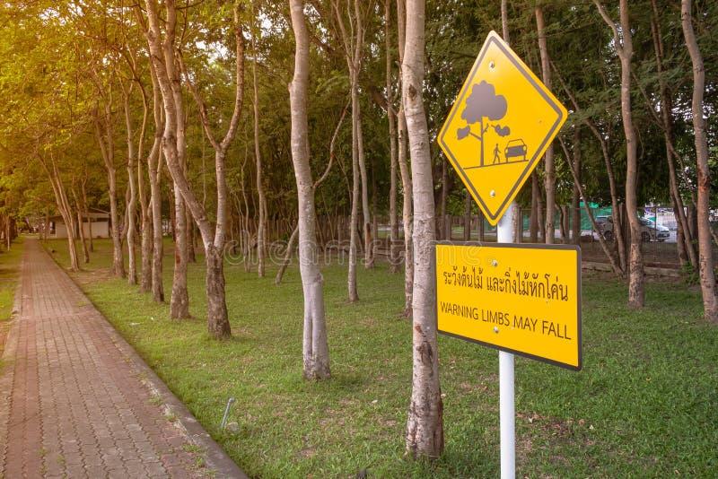 znak ostrzegawczy: kończyny mogą spadać zdjęcia royalty free