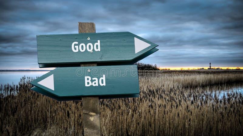 Znak Uliczny Dobry versus Zły obraz stock