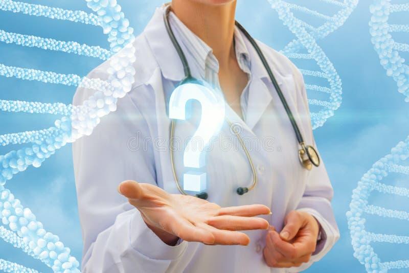 Znak zapytania w ręki lekarce zdjęcia stock