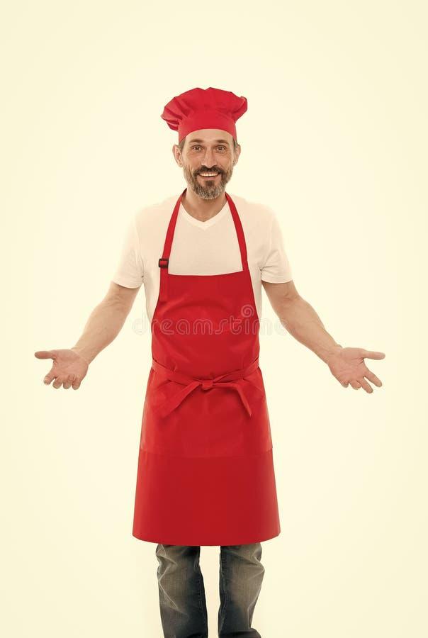 Znam Im masterchef Brodaty doro?le? m??czyzny w szefa kuchni fartuchu i kapeluszu Seniora kucharz jest ubranym ?liniaczka fartuch obrazy stock
