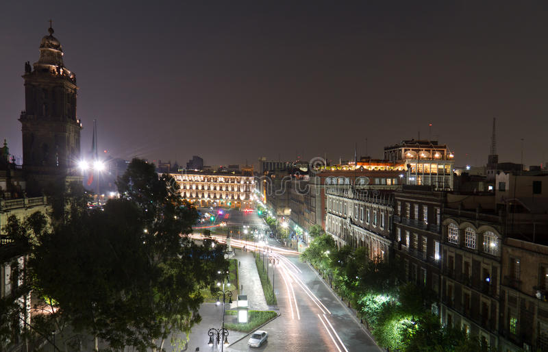 Zocalo. In Mexico City D.F. at night with the main cathedral on the left royalty free stock image