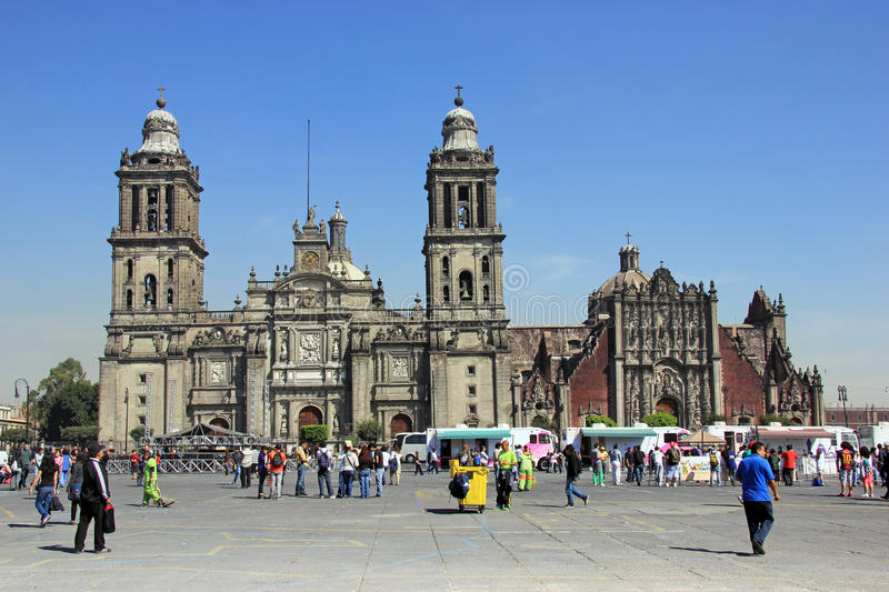 Zocalo, Mexico City. MEXICO CITY - FEBRUARY 2, 2013; People walk on the street on Plaza de la Constitucion, called also Zocalo, in front of Cathedral stock images