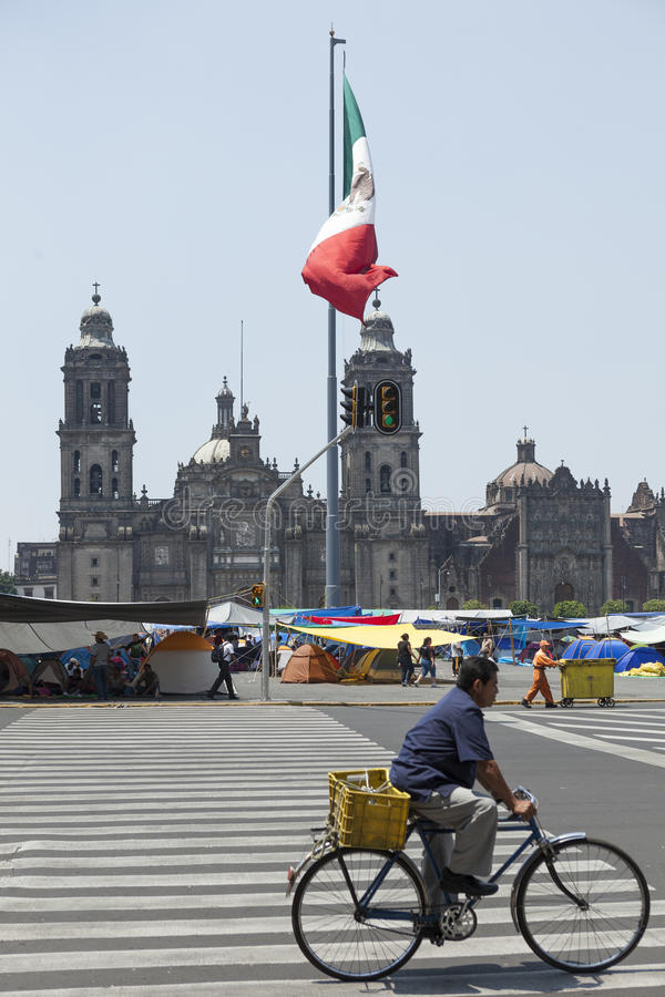 Zocalo, Mexico City. Mexico City, Mexico - May 28, 2012: Mexico City Cathedral and Zocalo Square with Mexican flag waving during a teachers` strike for better stock photos