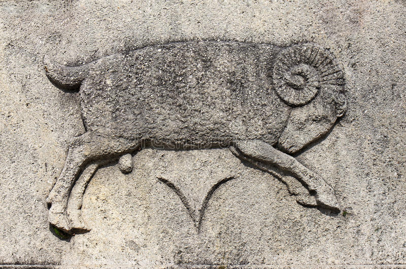 Zodiac - Aries or Ram. A stone relief stock photo