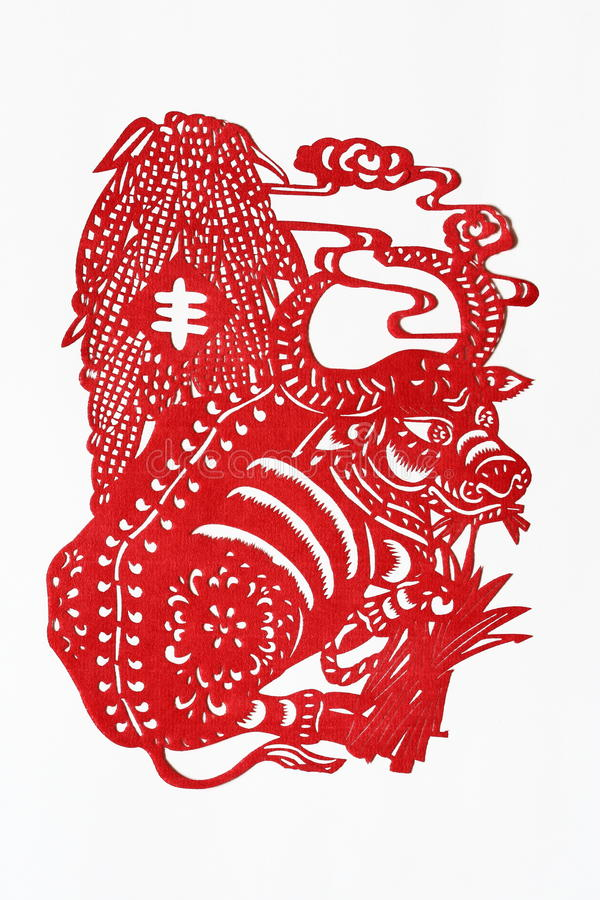 Zodiac Chinese Paper-cutting (Ox). Paper-cutting is a traditional Chinese folk art. The Chinese Zodiac is a scheme that relates each year to an animal and its royalty free stock image