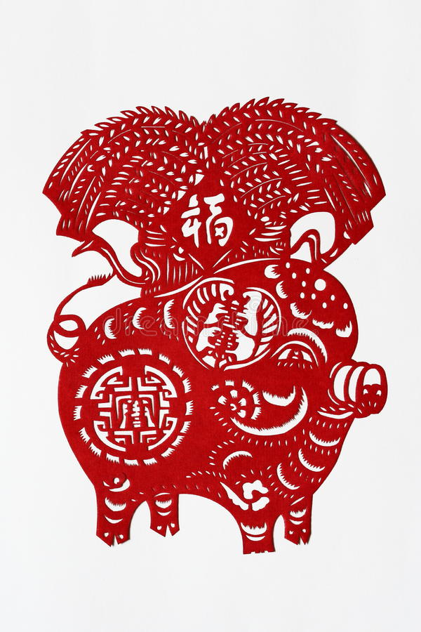 Zodiac Chinese Paper-cutting (Pig). Paper-cutting is a traditional Chinese folk art. The Chinese Zodiac is a scheme that relates each year to an animal and its stock images
