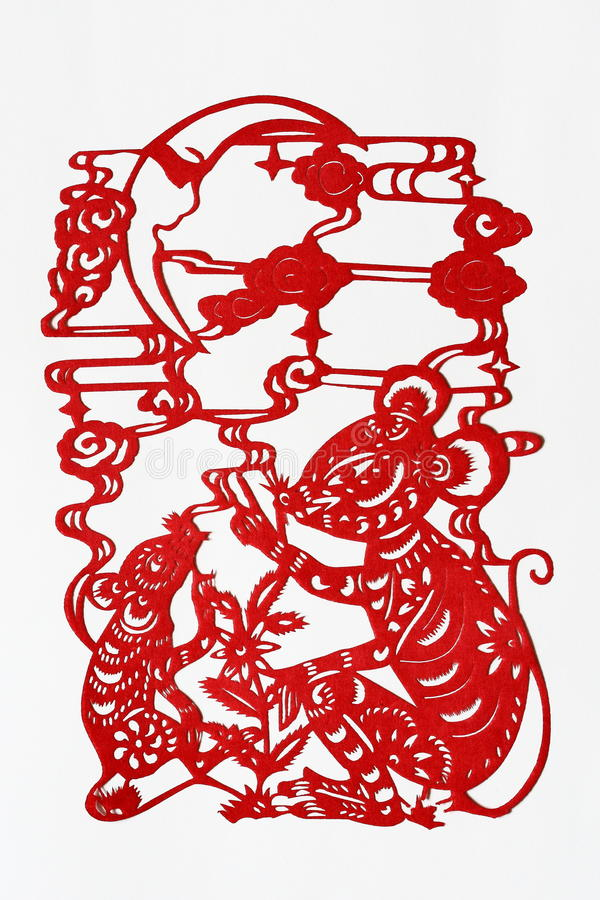 Zodiac Chinese Paper-cutting (Rat). Paper-cutting is a traditional Chinese folk art. The Chinese Zodiac is a scheme that relates each year to an animal and its stock image