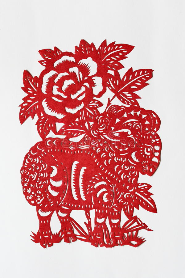 Zodiac Chinese Paper-cutting (Sheep). Paper-cutting is a traditional Chinese folk art. The Chinese Zodiac is a scheme that relates each year to an animal and its stock photo