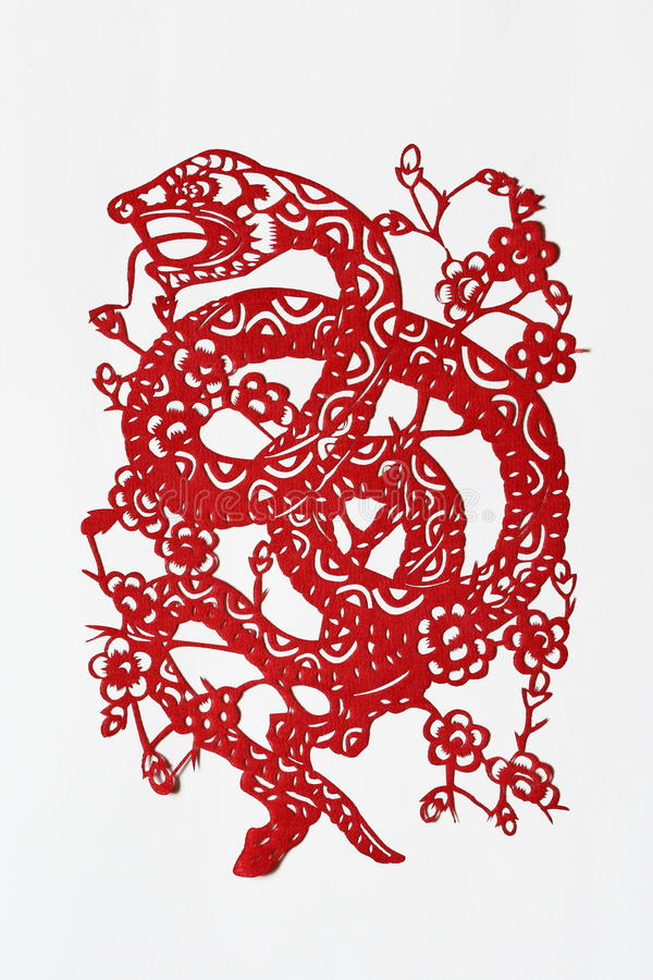 Zodiac Chinese Paper-cutting (Snake). Paper-cutting is a traditional Chinese folk art. The Chinese Zodiac is a scheme that relates each year to an animal and its stock photo
